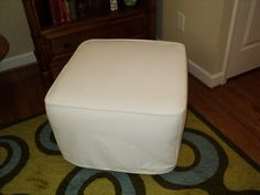 This is Pottery Barn's Discontinued Dream/Lullaby ottoman with a new DIYslipcovers slipcover.