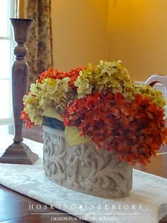 Red and gold hydrangea arrangement by Hosking Interiors
