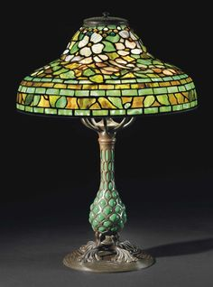 TIFFANY STUDIOS A 'JEWELED DOGWOOD' LEADED - GLASS AND BRONZE TABLE LAMP, CIRCA 1900.