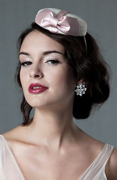 The pillbox hat adds a retro touch.  {Sophie} Swarovski Button Earrings by Enchanted Atelier