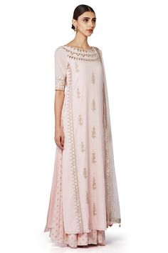 A beautiful pastel pink, straight style, gota patti detailed suit with a matching sheer dupatta and a printed sharara.
