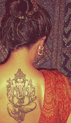 Ganesha Tattoo - like the colors, location, and that it looks like he's packin' heat