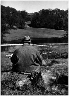 1951    British Prime Minister Winston Churchill with his poodle, Rufus, in the gardens of his Chartwell estate.