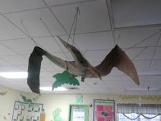 PreK students & teachers at the Cary, NC Knowledge Beginnings created their own Pterodactyl while studying dinosaurs. #dinosaurs #kindercare #knowledgebeginnings #knowledgeuniverse #kids #children #prek #preschool #kindergarten #dinosaur #Pterodactyl #school #classroom #museum #display #cary #NorthCarolina #NC