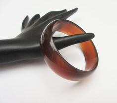 For your consideration is this root beer brown Lucite plastic bangle. It consist of marbled brown Lucite plastic. The #bangle has a curved outer layer. the with is 1 inch wi... #vintage #bracelet #teamlove #marbledbrown