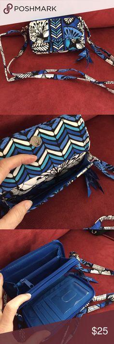 Vera Bradley Wallet Blue Bayou Vera Bradley wallet/mini-purse.  Detachable shoulder strap.  NWOT.  Matching shoulder hipster under separate listing.  Front pocket fits my iPhone 6. Vera Bradley Bags Wallets