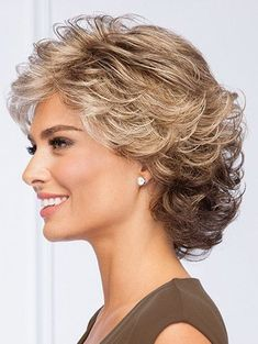 All-over loosely waved layers make styling this pretty, collar-length cut absolu. - - All-over loosely waved layers make styling this pretty, collar-length cut absolutely effortless. Short Hair With Layers, Short Hair Cuts For Women, Wavy Layers, Medium Hair Styles, Curly Hair Styles, Gabor Wigs, Eva Gabor, Short Curly Hair, Curly Bob