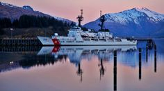 The United States Coast Guard Cutter Mellon arrives in Kodiak, AK. The Mellon is currently homeported in Seattle, WA. She once was homeported at Base Sand Island, Oahu, HI before swapping with the Cutter Munro. Alaska scenery provides spectacular backdrops for the cutters and the cutters have an important history in Alaskan waters. Many a periled fisherman and mariner have the USCG to thank for their lives.