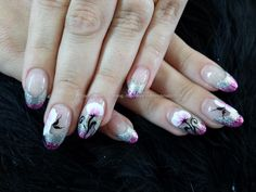almond nails with pink and silver glitter tips and one stroke flower nail art