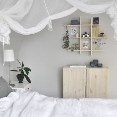 Love love love the grid shelving, wooden cabinet and canopy style white draping . #whitestyling #bedroom  @lokadoctoc