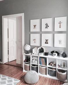 Grey and white bedroom decor playroom. Cube bookshelves for heaps of storage for toys anf kids books.  Love the baskets. Framed prints.  Boys bedroom idea.
