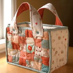 This would make a cute diaper bag. PATCHWORK TOTE