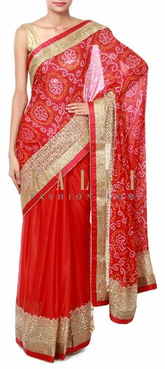Buy Online from the link below. We ship worldwide (Free Shipping over US$100). Product SKU - 315960. Product Price - $199.00. Product link - http://www.kalkifashion.com/red-bandhani-saree-featuring-in-sequin-and-kardana-embroidery-only-on-kalki.html