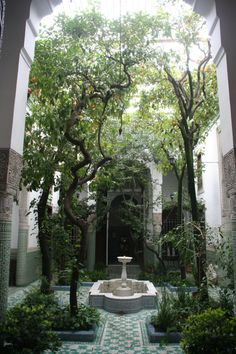 Tiled courtyard and fountain.