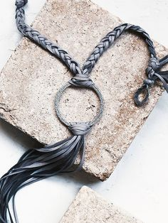 Free People Canyon Fringe Pendant, $198.00 Supplies: Leather strips, silver round piece, button