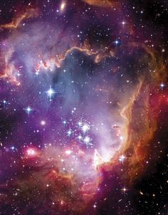 This Hubble image of starbirth region NGC 602 combines data from the Spitzer and Chandra space telescopes. - Image credit: NASA / ESA / CXC / University of Potsdam / JPL-Caltech / STScI