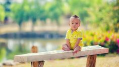 Happy Boy Sitting on Bench