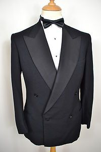 A VINTAGE 1940's BURTON MEN'S WOOL 2-PIECE TUXEDO SUIT - WITH ORIGINAL BRACES! The name's Bond... Item Description: A MEN'S UK SMALL 38 REGULAR (detailed measurements given below). Black colour. Four buttons. Double breasted. Slit pockets at the waist, a slit pocket at the upper left breast. Triple button cuffs. 100% Wool. Black lining with one inside pocket. Genuine 1940's English vintage, hand-tailored in England by Burton. With matching trousers.