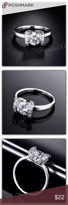 🆕18K White Gold Simulated Diamond Gorgeous Ring! An intricately designed ring made to perfection! Sparkling 7mm Main Stone accented by 5 more stones on each side! Gorgeous detail & shine; will make a perfect wedding/anniversary or anytime Ring!  • Main Stone: 7mm Round Simulated Diamond • Will be shipped Securely in Jewelry Box • Please see last pic for full description👌  *NO TRADES *Prices are FIRM-Listed at Lowest Price Unless BUNDLED! *Sales are Final-Please Read Descriptions! Boutique…