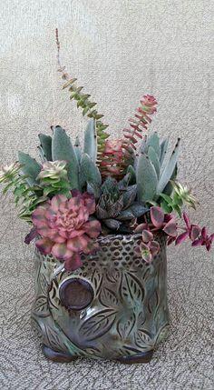 Nice colors in a pretty arrangement by Paula Deubig in a Donna Davis Taylor pot.