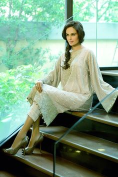Faraz Manan's Eid Collection | So wearable, so timeless, so gorgeous. I don't know how between his Lawn, Pret a Porter and Couture he's even managed this BUT SiddySays Verdict – LOVE! I mean just say 'Cotton Silk Jacquard Kurtas with embellishment and Chiffon Chikankari Kurtas' sounds nice even saying it. PLUS, the detailing on the trousers is amazing!