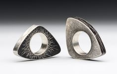 Contemporary Jewelry Design by Andrea Williams: Opposites Attract Rings: Created to be worn by the most unlikely of couples. These diametrically opposed rings reflect core similarities. Beach stones, sterling silver and fine silver.