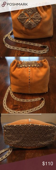 Purse Liquid Metal camel suede and metal purse medium size purse that has that rock star look. It's a very sexy purse that comes with a silver chain strap and metal mesh bottom  may be worn over the shoulder or cross body magnetic snap closure liquid metal Bags Shoulder Bags