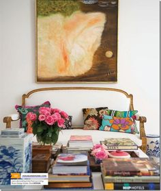 art, antique sofa, mixed pillows, coffee table full of books, ginger jars, odd curiosities