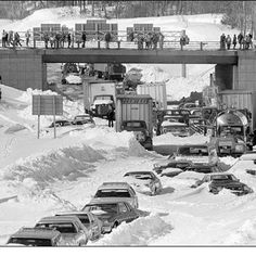 Cars and trucks stranded and abandoned in deep snow along Route 128 in Dedham, Mass., are seen in this Feb. 1978 photo, as military and civilian plows begin to dig them out during the blizzard of Minnesota, State Of Michigan, Detroit Michigan, Detroit Area, Metro Detroit, Cleveland Ohio, Columbus Ohio, Cincinnati, Minneapolis
