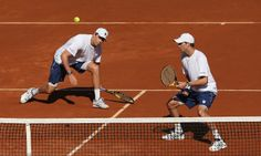 Bob Bryan and Mike Bryan of the US, seen in action against Colin Fleming and Dominic Inglot of Great Britain in their doubles match during d...