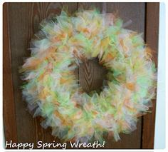 Tulle wreath tutorial...----I love my wreath I went with a football theme GEAUX TIGERS ;) It's purple, yellow and white with purple painted L S U letters and a cute little football :) It took me 2 days to make but I had to keep putting it down...<3 it! Now on the the next LSU wreath :D