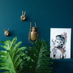 The Gold Rock On Hand Hook is a quirky way to add depth and character to a picture wall gallery, or simply to hang things around the home. Blue Accent Walls, Accent Walls In Living Room, Living Room Paint, Dining Room Blue, Dining Room Walls, Green Paint Colors, Wall Ornaments, Front Rooms, Gold Walls