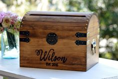 Personalized Wedding Card Box, Wood Wedding Card Box With Slot, 5th Anniversary Gift, Wedding Memory Chest, Custom Keepsake Trunk  DESCRIPTION: Our customized card box is made from solid wood with metal accents, stained and personalized to your requests. We can engrave your family name and established date on the front or we can customize it with your choice of wording!  SIZE: Choose your size from the drop box beside the picture! 7x6x5 10x8x8 12x10x10 PERSONALIZE IT: Leave the phrase, words…