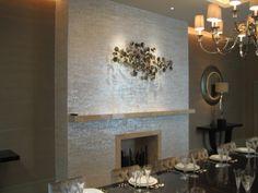 Maya Romanoff's Mother of Pearl tiles featured on a gorgeous fireplace @Maya Romanoff