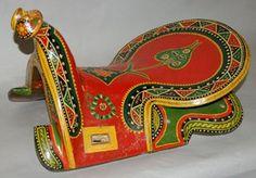 Saddle; wood;  Date1990s Yining, China,Xinjiang (autonomous region) DimensionsHeight: 26 centimetresWidth: 32.5 centimetresDepth: 47 centimetresWeight: 2.76 kilograms