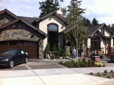 rock and stucco  houses | Gorgeous house. Love the stucco and stone with the dark garage doors.