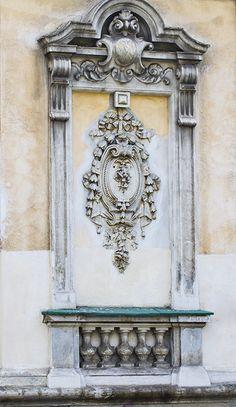False window with emblem and false balcony
