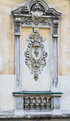 False window with emblem and false balcony