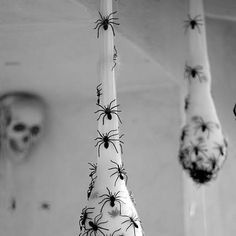 Make your own Spider Egg Sacs!! Take white hose and fill it with stuffing. Use plastic spiders on the inside and glue some on the outside, too! YUCK!! This is a creepy DIY Decoration!!