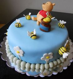 Winnie the Pooh baby cake OMG I love this cuz it's blue for gender and looks fairly easy minus beas and bear