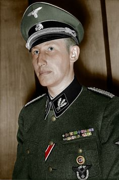 "the face of evil ... reinhardt heydrich :: Brave & very smart German military leaders also had to deal with ""Cowardly/Yellow Draft Dodgers"" like our Vietnam Draft Dodging coward, the yellow bellied Cassius Clay! Fortunately the more intelligent German excluded such inadequate negroes! Consequently, the Caucasian German soldiers almost conquered Earth!"