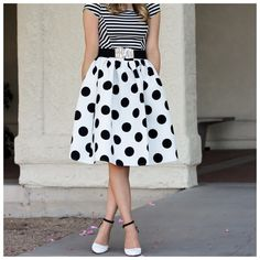 "White & Black Satin Full Swing Polka Dot Skirt ‼️PRICE FIRM‼️   Polka Dot Skirt Size One Size  Retail $99  SPECTACULAR! Words can not describe how beautiful this skirt is. One size, waistband stretches to fit your waist. Side Zip. Half lined for the full feminine look. 65% polyester, 35% cotton with a spandex elastic waistband. Please check my closet for many more items including designer clothing, scarves, jewelry, handbags, shoes & much more.  Waist 25""-32""  Length 26"" Handmade Skirts"