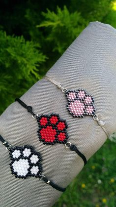 gifts for cats Miyuki bead pet paw print bracelet. It is made with special miyuki beads. What are miyuki beads? They are beads specially cut as every one of them Gifts For Pet Lovers, Cat Gifts, Gift For Lover, Dog Lovers, Pet Paws, Brick Stitch, Beading Patterns, Seed Bead Patterns, Beaded Bracelets