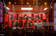 Guitarist Charlie Burchill, singer James Kerr and drummer Mel Gaynor of Simple Minds perform onstage during the 2015 Billboard Music Awards at MGM Grand Garden Arena on May 17, 2015 in Las Vegas, Nevada.