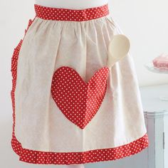 This retro-style reversible apron has a large heart-shaped pocket on one side. It's so easy to make and perfect for Valentines cooking