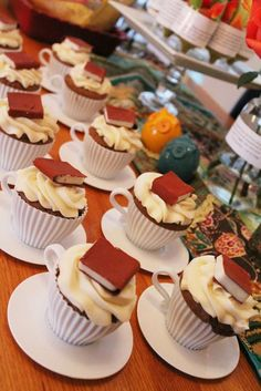 serve cupcakes in mini teacups with edible books perched on top!