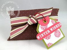 "A cute idea for hiding a gift card or small gift in a stocking! This Pillow box is embossed with the ""polka dots"" embossing folder"