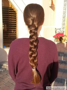 Nice 19 inches long, 5.25 inches thick, virgin, medium-brown hair with natural highlights
