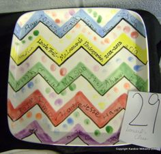 Class project for school auction. Chevron stripes on large square plate / platter - kids' names written on the stripes & thumbprint dots