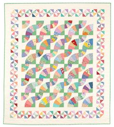 Whirling Fans quilt with Pinwheel border